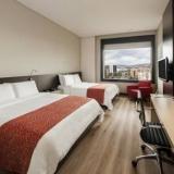 """Haabitación con dos camas Hotel Radisson AR Bogotá Airport - <a href=""""http://www.booking.com/hotel/co/ar-salitre-suites-spa-centro-de-convenciones.html?aid=384790;label=hotelgallery#availability_target"""" rel=""""nofollow"""">Reserva ahora</a>"""