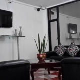 "Sala de Televisión - <a href=""http://www.booking.com/hotel/co/ag-boutique-home.html?aid=384790;label=hotelgallery#availability_target"" rel=""nofollow"">Reserva ahora</a>"