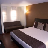 "Habitación Business con cama extragrande - <a href=""http://www.booking.com/hotel/co/santa-barbara-real.html?aid=384790;label=hotelgallery#availability_target"" rel=""nofollow"">Reserva ahora</a>"